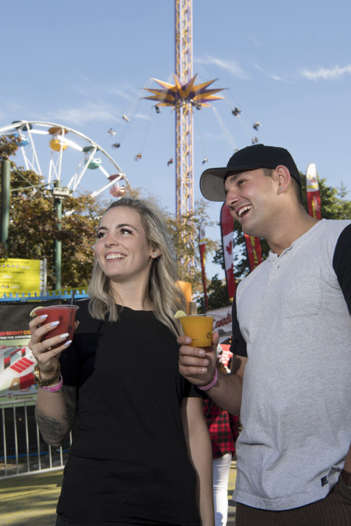 couple smiling at playland